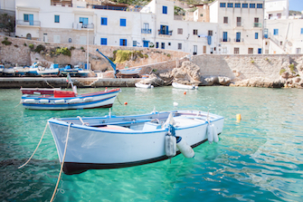 sicily guide holiday information sicilian cities travel sightseeing sicilian islands aegadian islands levanzo harbour fisherboats sea