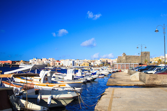 sicily guide holiday information sicilian cities travel sightseeing sicilian islands pantelleria castle harbour fisherboats sea